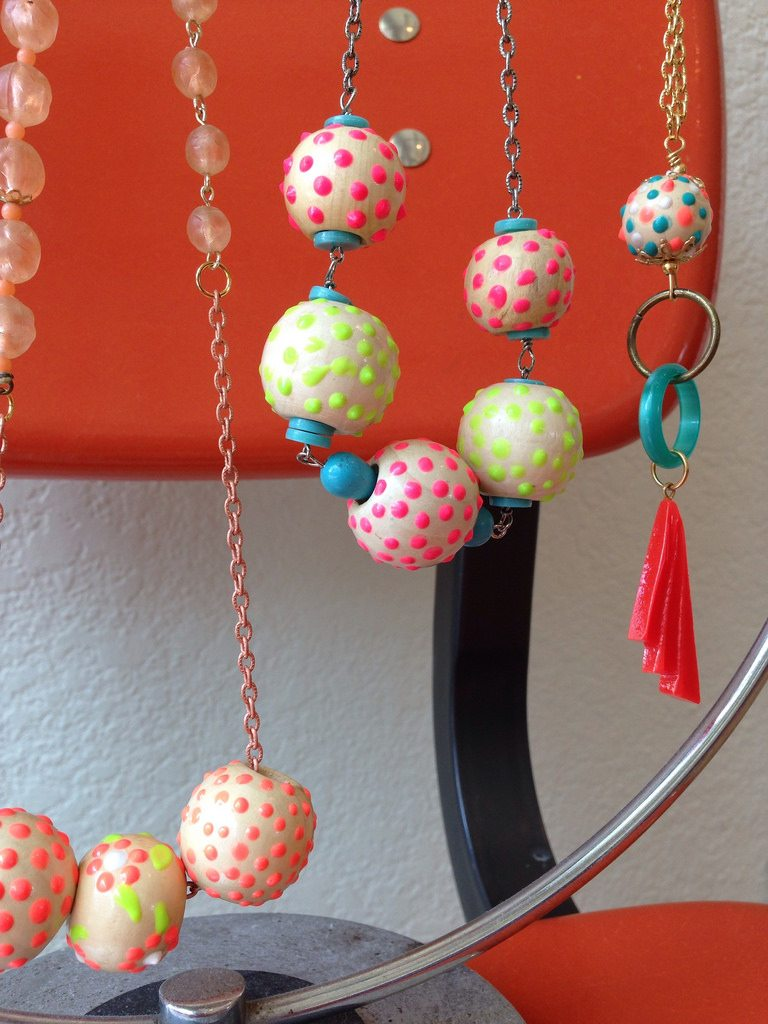 Wooden beads embellished with craft store paint.