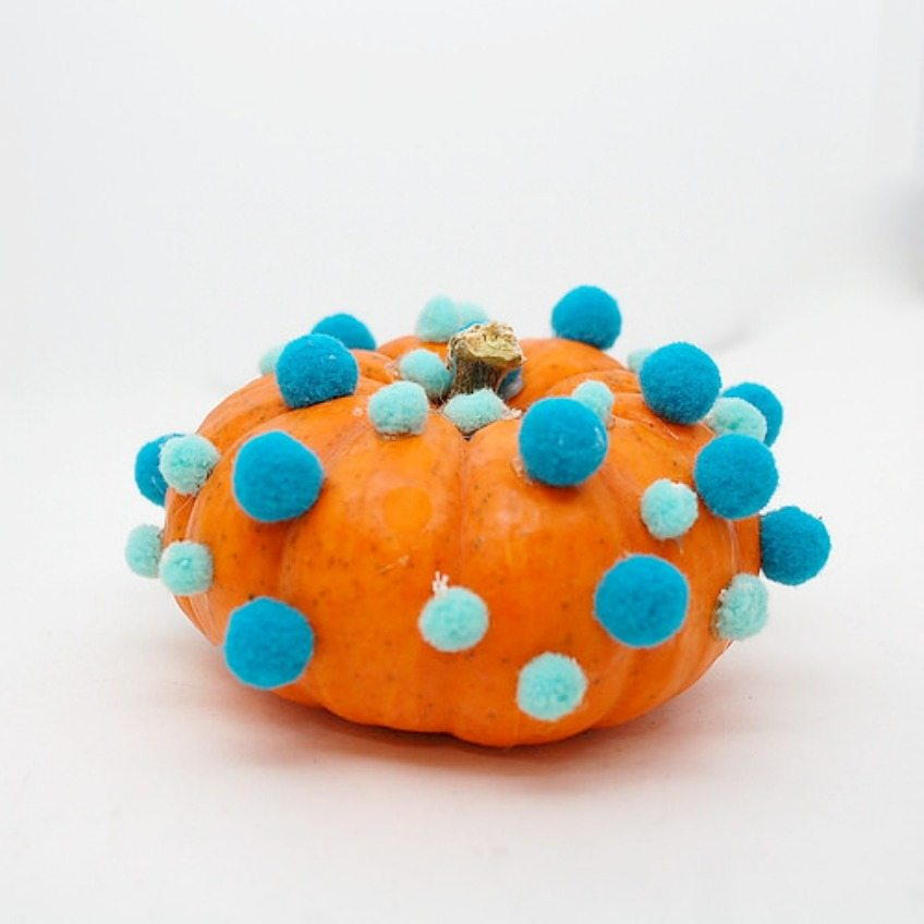 Pompom Covered Pumpkins for Halloween by Jennifer Perkins