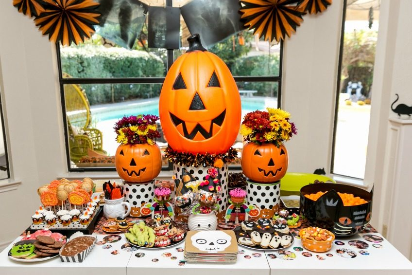 Lavish colorful Halloween treat table by Jennifer Perkins