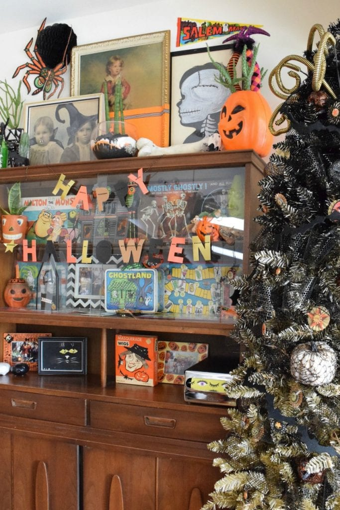 Gold and black ombre tree decorated for halloween by Jennifer Perkins