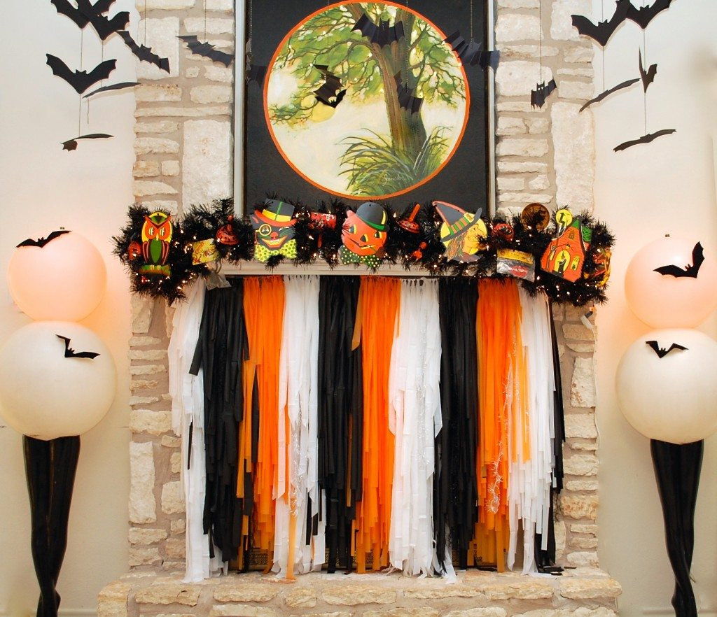 Halloween mantle with custom light-up art and DIY fireplace screen by Jennifer Perkins