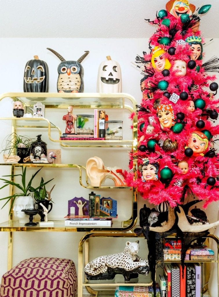 Hot pink tree with vintage Halloween masks and doll parts by Jennifer Perkins