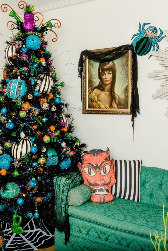 Black Halloween tree decorated with teal pumpkins by Jennifer Perkins