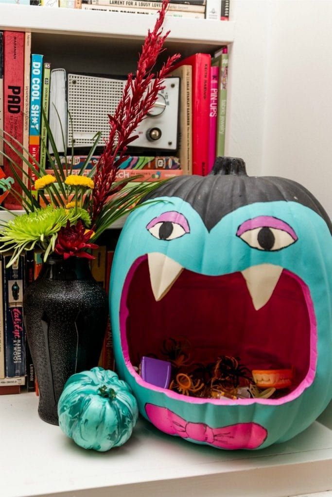 Teal pumpkin carved to look like a vampire Halloween candy dish by Jennifer Perkins