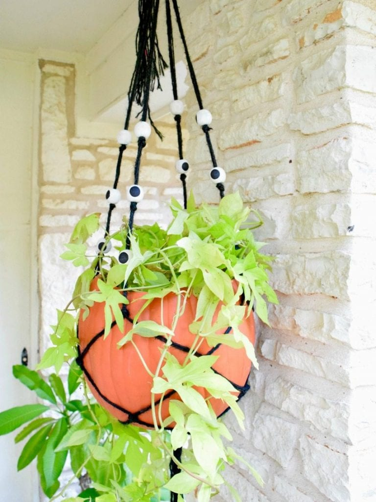 DIY hanging pumpkin planter made with macrame and eyeball beads by Jennifer Perkins
