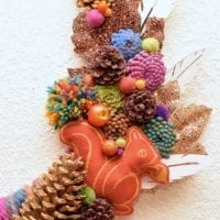 Fun wreath with pinecone flowers and yarn by Jennifer Perkins