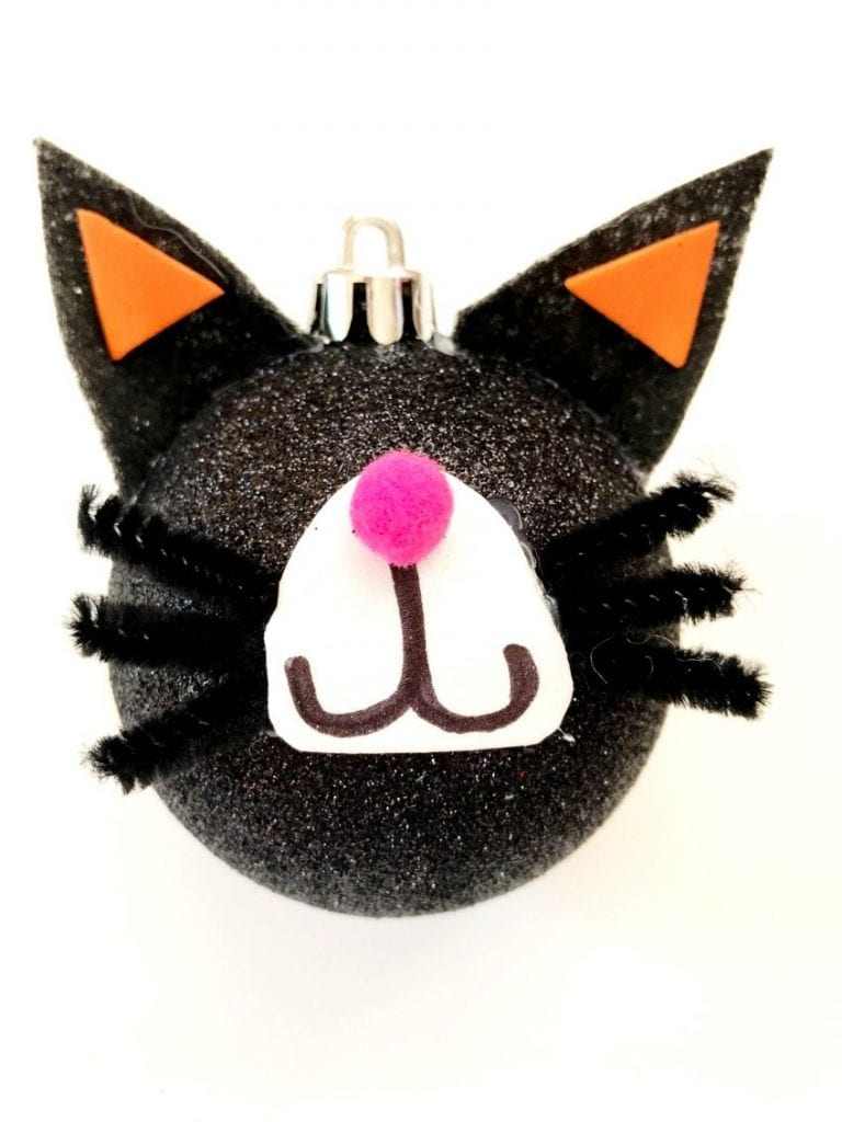 Assembling a DIY cat ornament for Halloween by Jennifer Perkins