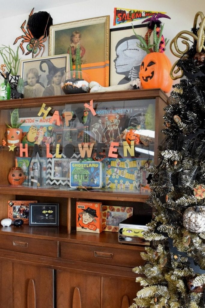 Halloween curio cabinet with vintage collectibles by Jennifer Perkins