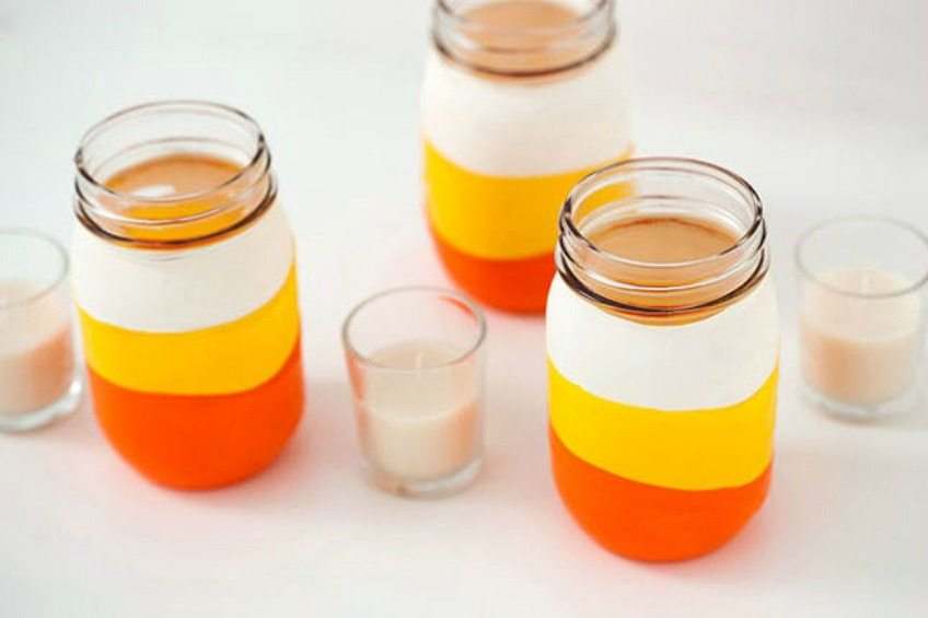 Balloon dipped candy corn mason jars by Brit and Co