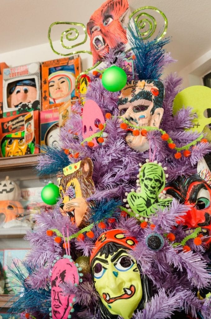 Purple Halloween tree with vintage monster masks by Jennifer Perkins