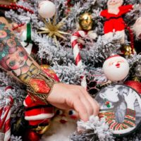 Jennifer Perkins Christmas tattoo and DIY embroidered ornament.