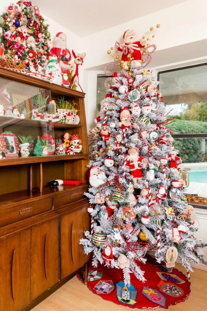 gorgeous flocked christmas tree full of a vintage santa doll collection by jennifer perkins