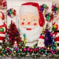 Christmas mantle full of vintage Santa blow molds by Jennifer Perkins