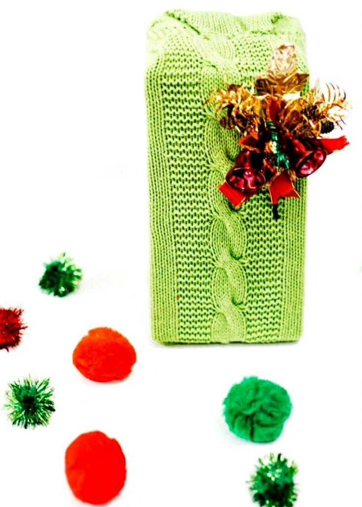 Use an old sweater to wrap gifts by Jennifer Perkins