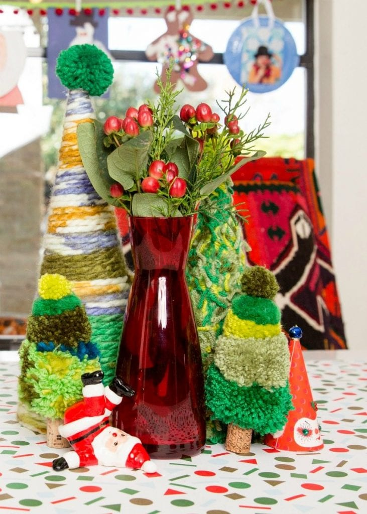 Make a forest full of DIY yarn pompom Christmas trees by Jennifer Perkins