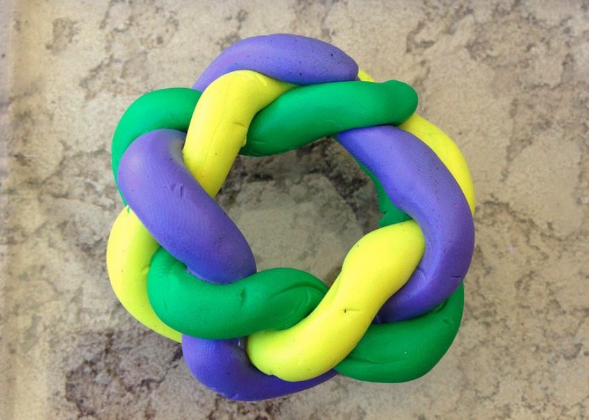 Braid clay snakes into a King Cake shape.