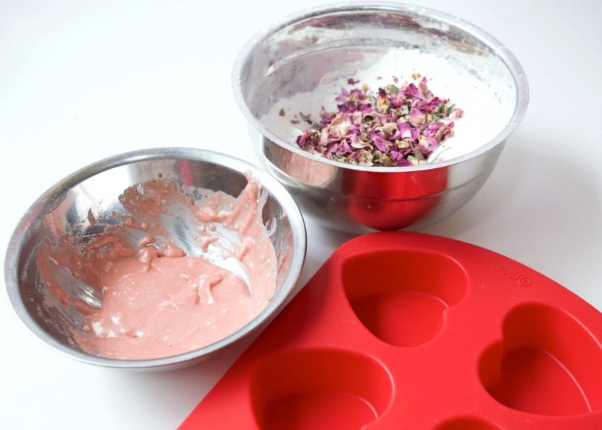 Mixing wet and dry ingredients for DIY bath bombs by Jennifer Perkins