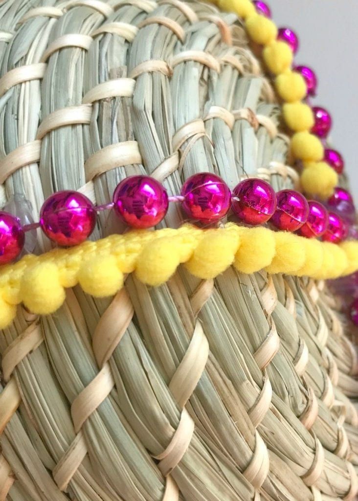 Add decorative trim along with the beads to the sides of the basket.
