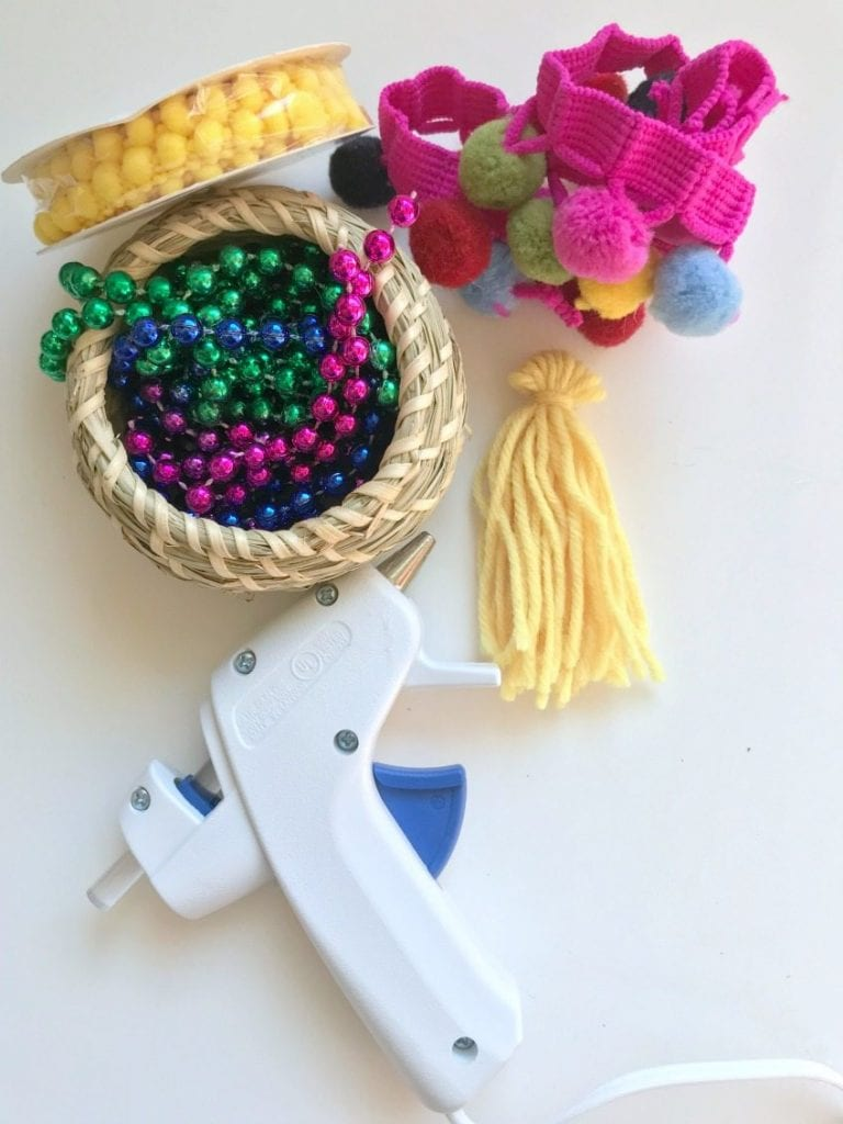 All the supplies you need for making a hanging planter from a basket and Mardi Gras beads by Jennifer Perkins