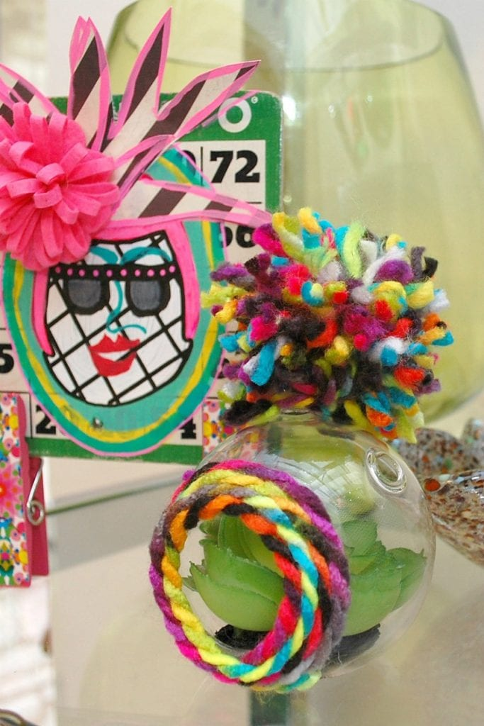 Embellished glass terrarium with yarn trim and pompoms by Jennifer Perkins
