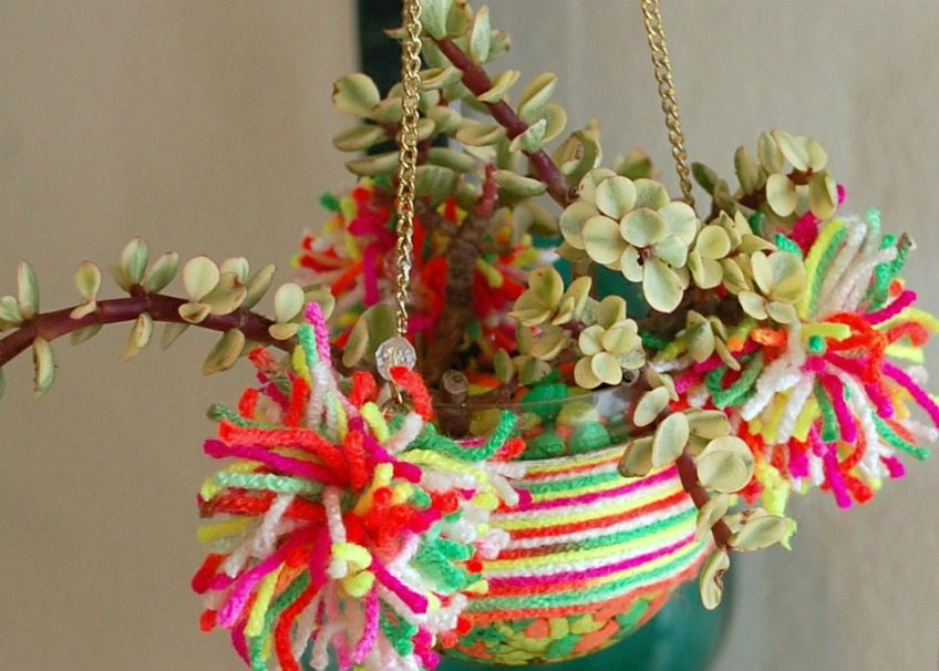 Wrap a hanging terrarium with yarn and pompoms for a fun boho spin by Jennifer Perkins