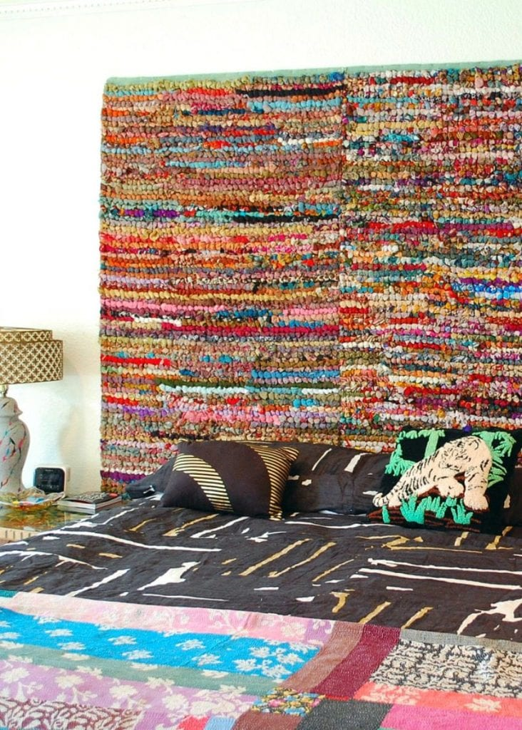 How to turn colorful rugs into a headboard for your bed by Jennifer Perkins