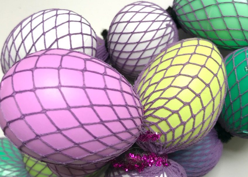 Wrap eggs in fishnet pantyhose - this will act like a mermaid scale stencil.