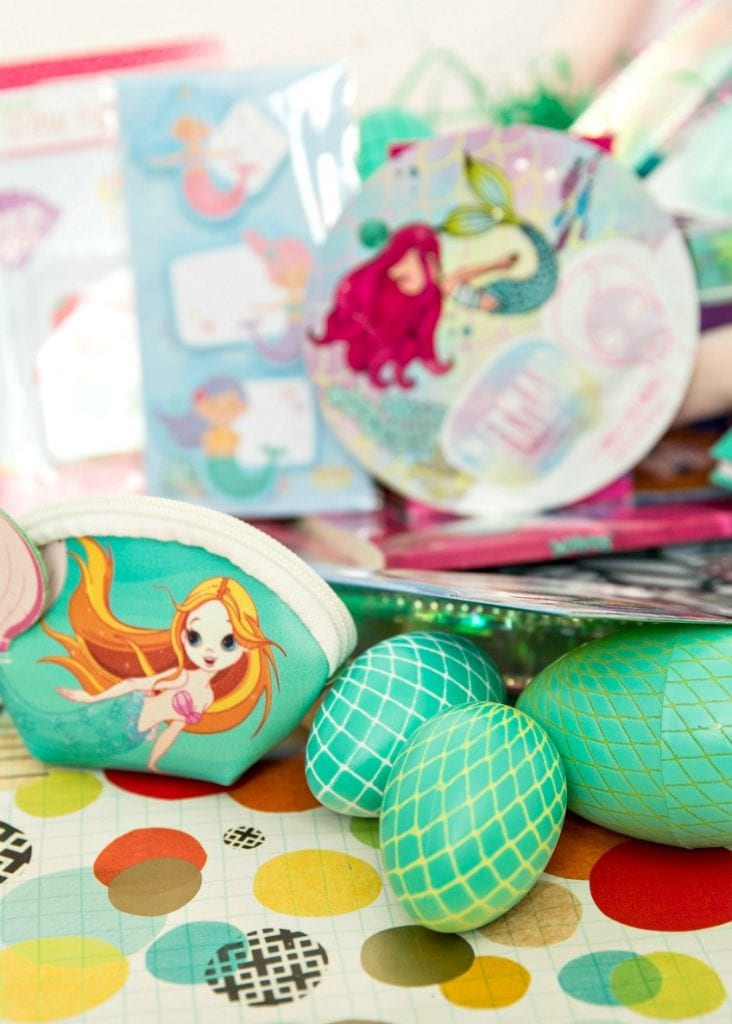 Easter basket full of mermaid themed goodies including DIY mermaid tail Easter eggs by Jennifer Perkins
