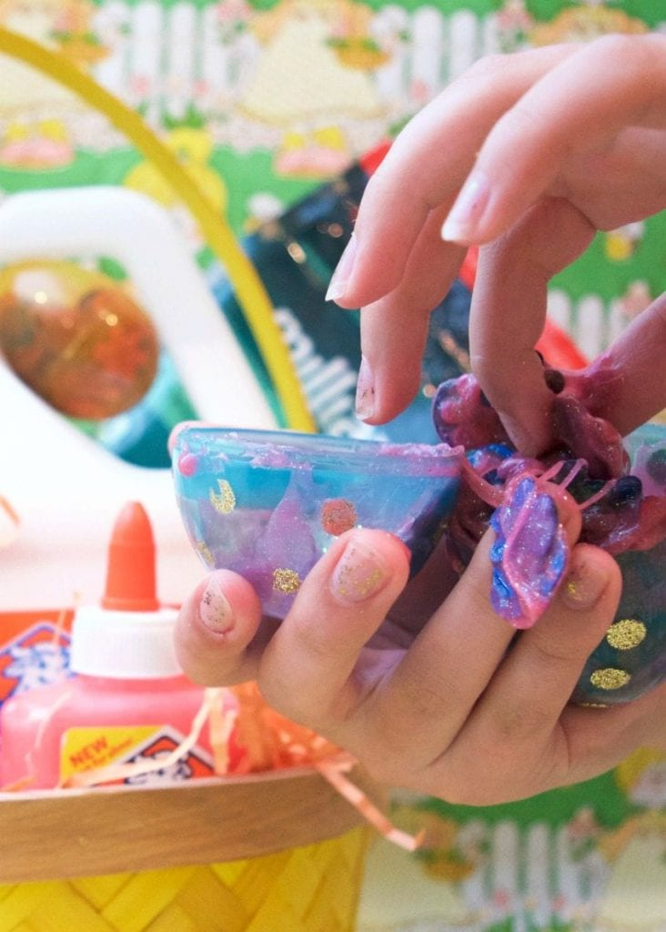 Fill clear Easter eggs with slime that has egg and bunny confetti inside.