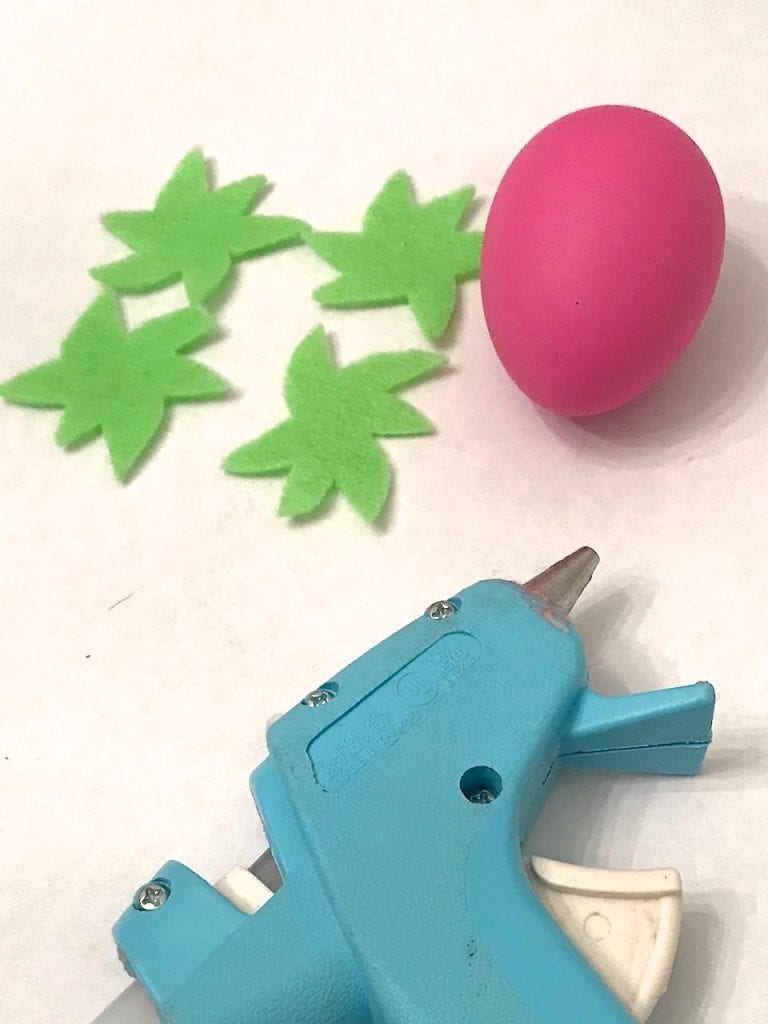 Cut green felt into leaf shapes for strawberry Easter eggs. - Jennifer Perkins