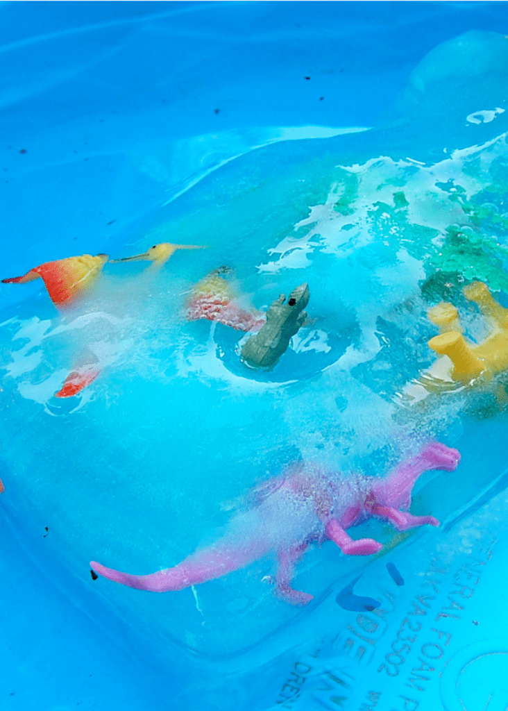 Freeze plastic toy dinosaurs into a block of ice - perfect for an ice dinosaur excavation. by Jennifer Perkins