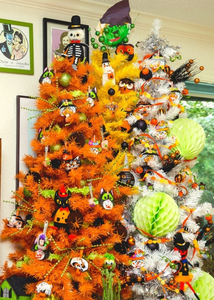 White, yellow and orange Christmas tree grouped together for a Halloween candy corn forest by Jennifer Perkins