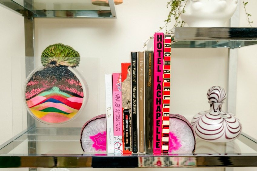 Colorful styled etagere with succulents, books and murano glass by Jennifer Perkins