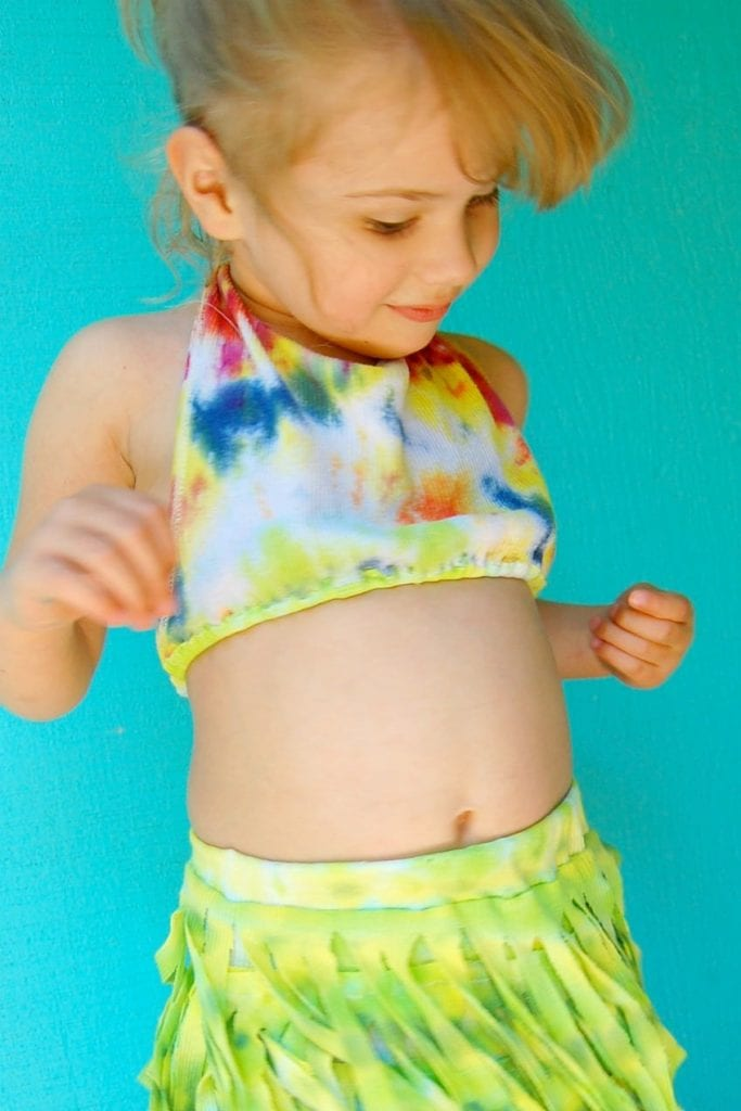 How to turn a tie-dye t-shirt into a DIY hula skirt for kids.