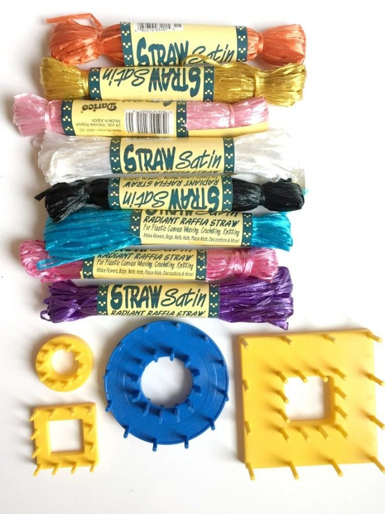 Vintage craft supplies including plastic raffia straw for flower looms.
