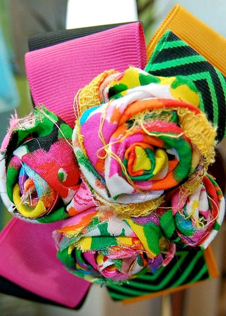Colorful flowers made with rolled scrap fabric pieces by Jennifer Perkins