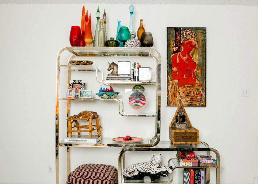 Vintage Milo Baughman etagere styled with a collection of colorful vintage glass by Jennifer Perkins
