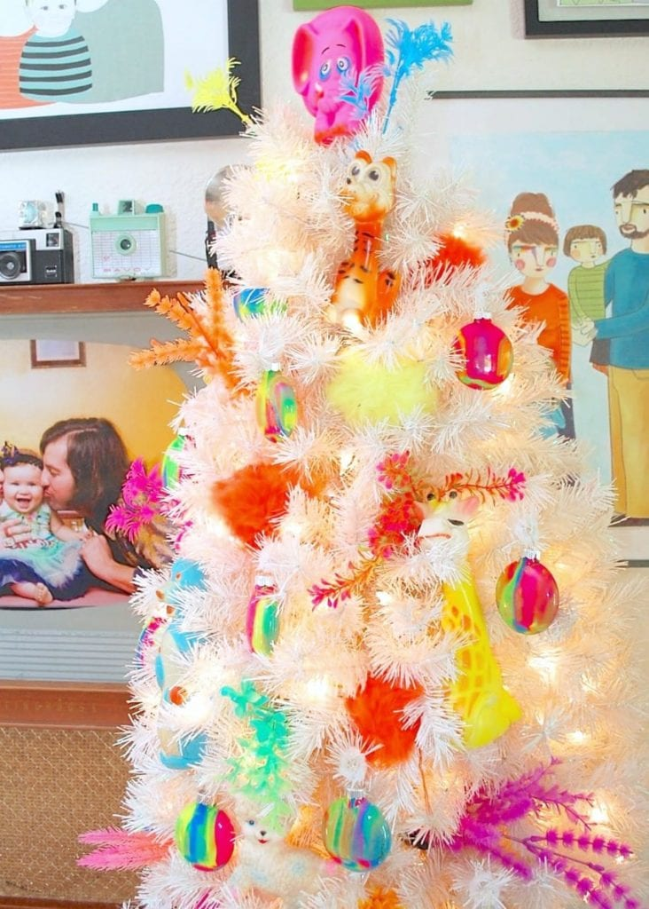 Celebrate National Thrift Store Day with a Christmas tree decorated with thrift scores.