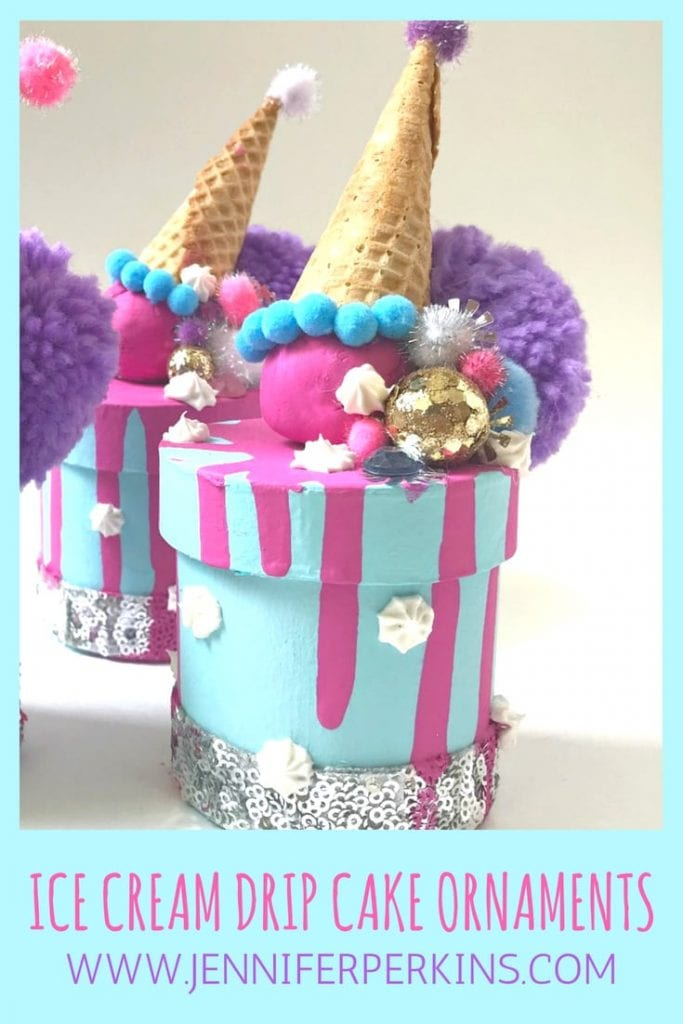 DIY spilled ice cream cake boxes in blue with pompoms.