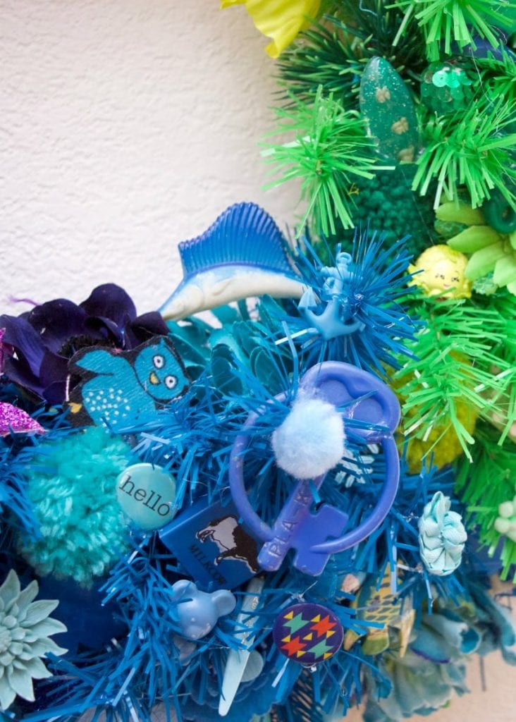 Vintage swordfish on blue portion of a rainbow wreath.