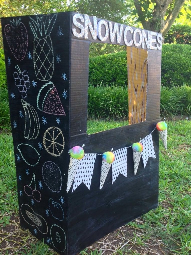 Make the kids a DIY snow cone stand with chalkboard paint walls.