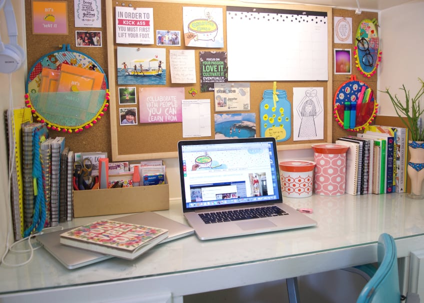 Organized built in desk with cork board and embroidery hoop wall pockets.