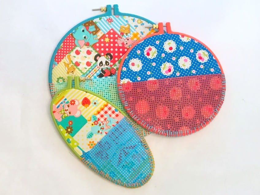Finished embroidery hoop wall pockets by Jennifer Perkins.
