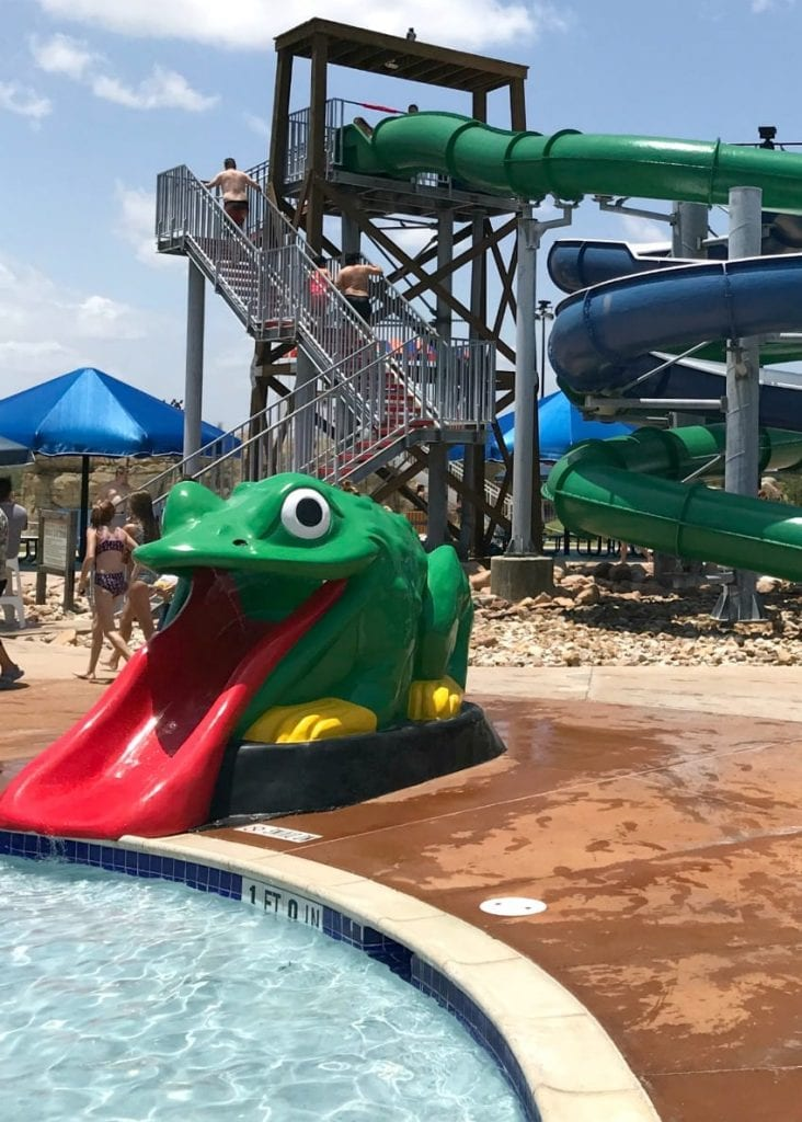 Frog slide going into baby pool at Rockin River water park.