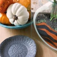 Small clay dish for Halloween made with a doily pressed into clay to look like a spider web by Jennifer Perkins