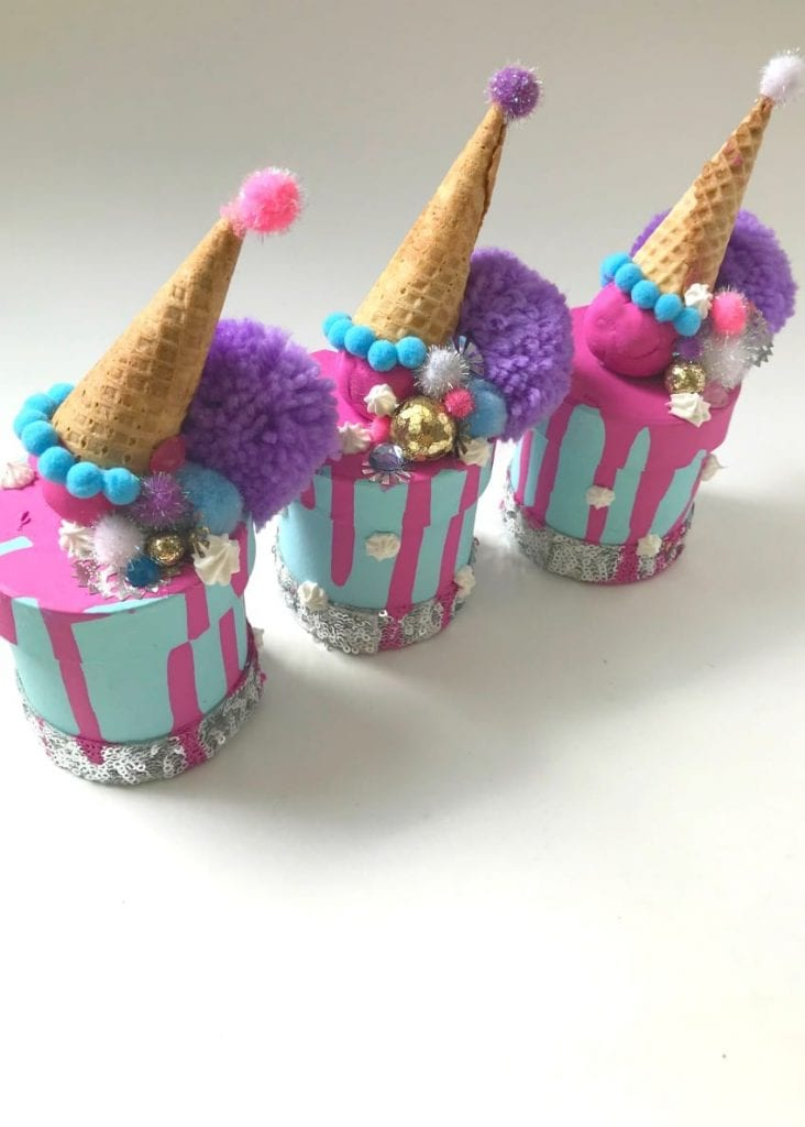 Spilled cake boxes with faux dripping ice cream cone ornaments.