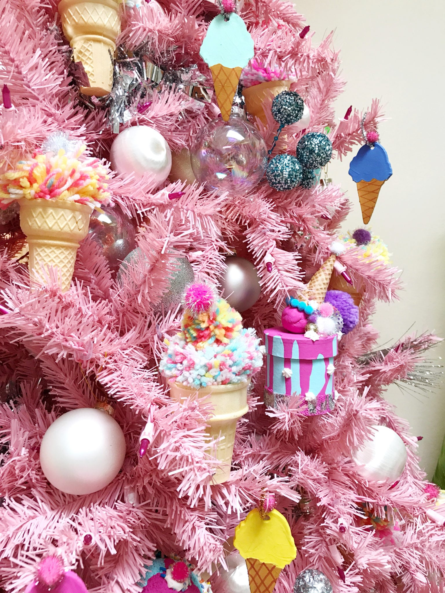 Pink Christmas tree with an ice cream theme and DIY ice cream cone ornaments.