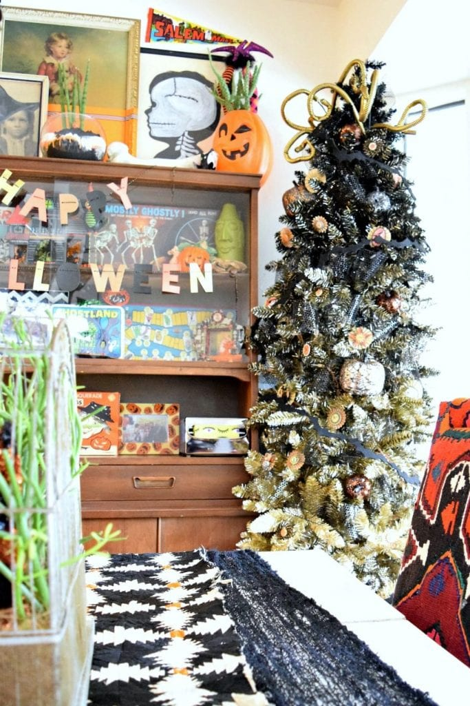 a dozen ideas for how to decorate a black christmas tree for halloween jennifer perkins