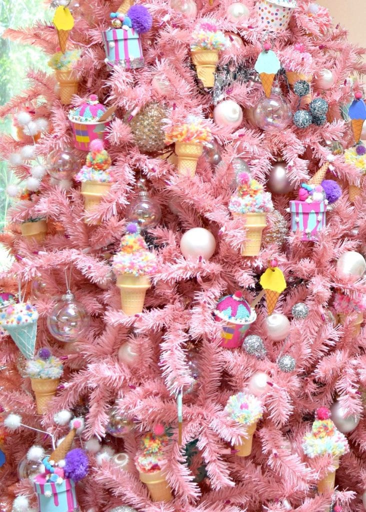 Large pink Christmas tree decorated with DIY ice cream themed ornaments for National Ice Cream Day.
