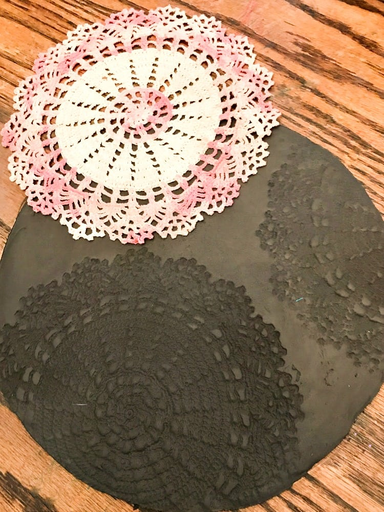 Remove doily from clay to reveal impression like a spider web.